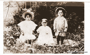 The three children about seven years before this story.