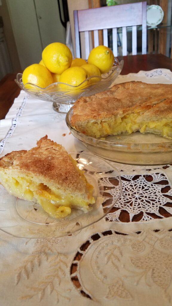 Whole Lemon Pie with dish of lemons